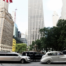 white-retro-car-and-new-limousine-ride-along-the-street-in-new-york_8353-1464